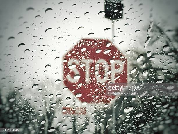 stop sign seen through wet vehicle window in rainy season - kathy shower stock pictures, royalty-free photos & images