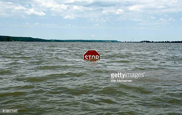 A stop sign stands alone in the floodwaters of the Mississippi River June 21 2008 in Winfield Missouri Flooding continues in Iowa Missouri and...