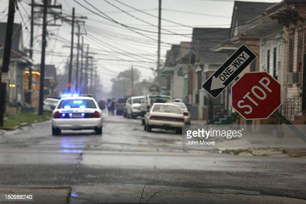 A stop sign stands askew after being blown by Hurricane Isaac on August 29 2012 in New Orleans Louisiana The system which was downgraded to a...