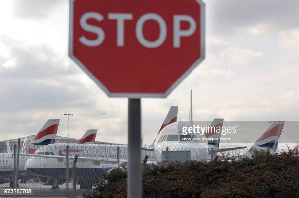 stop sign with British Airways Airbus A321200 A320s and A319s parked during the strike by British Airways cabinattendants of the Unite tradeunion and...
