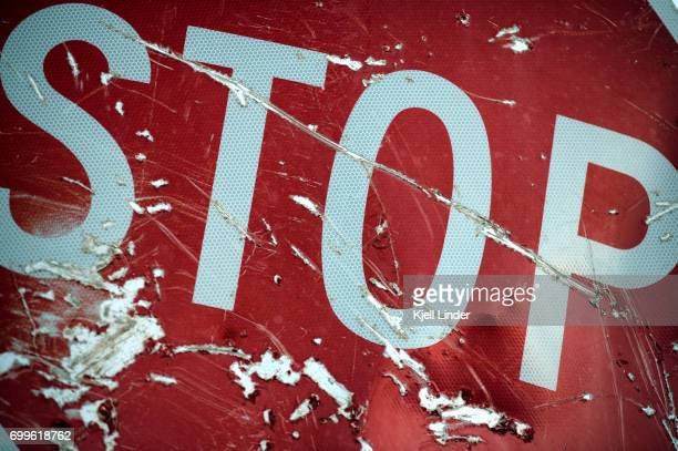 stop sign with scratches - motorcycle accident stock pictures, royalty-free photos & images