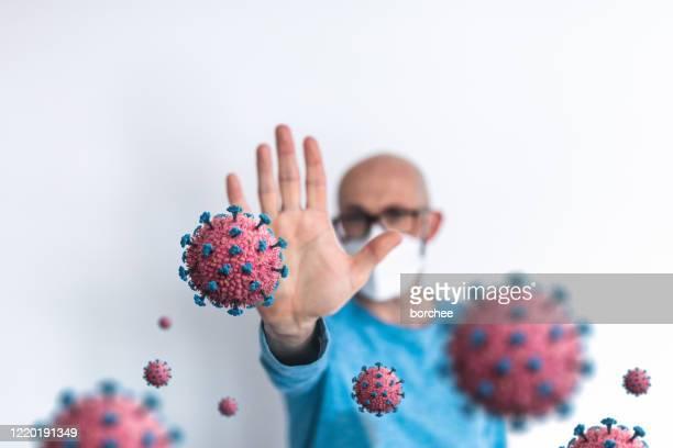 detener el mensaje de coronavirus - untar fotografías e imágenes de stock