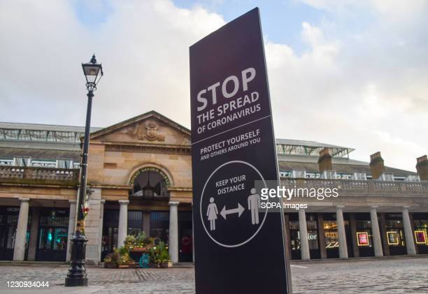 Stop The Spread Of Coronavirus' sign in an empty Covent Garden, London. The coronavirus lockdown remains in place across the UK as the nation...