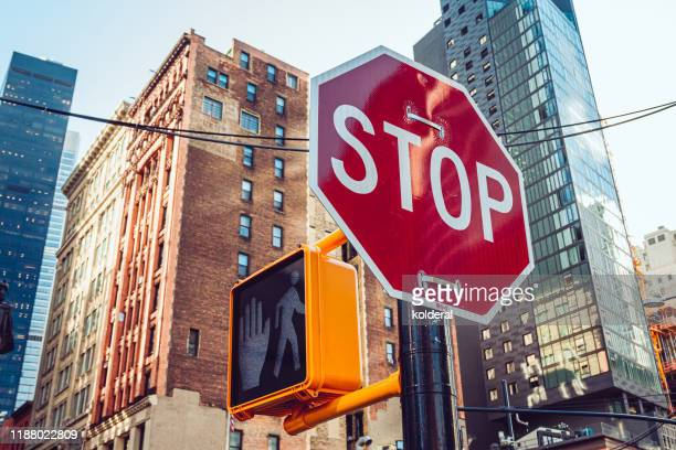 stop traffic sign and pedestrian walk don't walk signal in midtown manhattan - stop sign stock pictures, royalty-free photos & images
