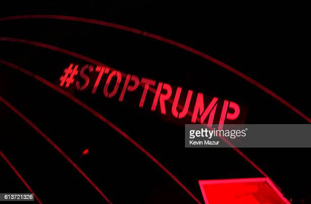 Stop Trump hashtag is seen on the underside of the Together We Stand Divided We Fall pig float during the Roger Waters performance at Desert Trip at...