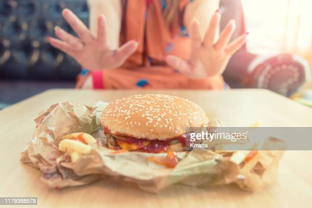 stop unhealthy eating - eating disorder stock pictures, royalty-free photos & images