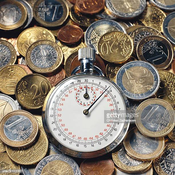 Stop watch and assorted coins.