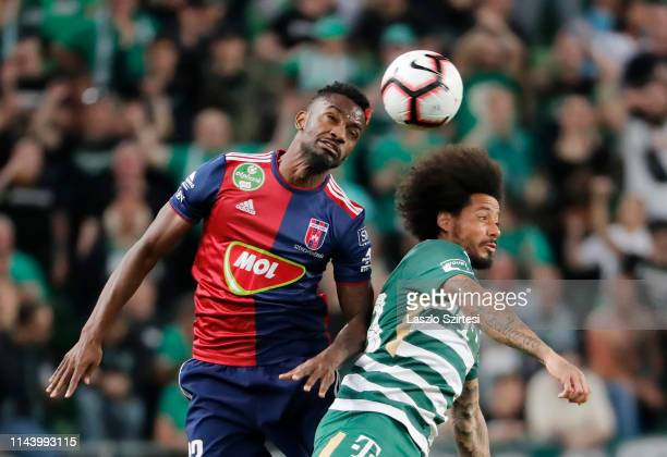 Stopira of MOL Vidi FC battles for the ball in the air with Isael da Silva Barbosa of Ferencvarosi TC during the Hungarian OTP Bank Liga match...