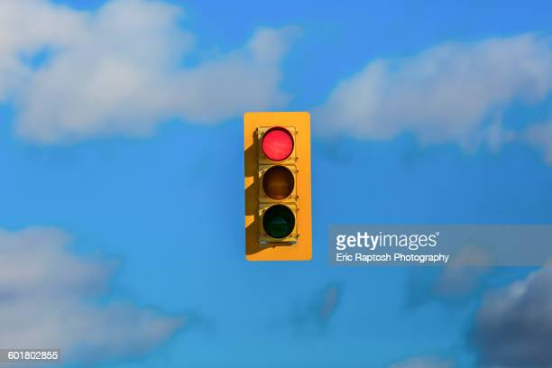 Stoplight floating in sky