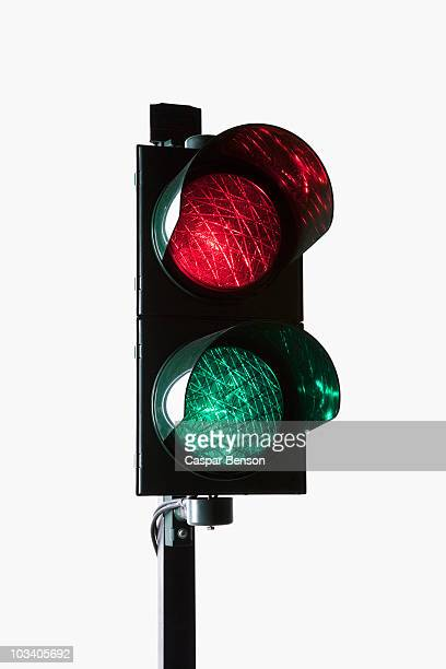 A stoplight with both the red light and green light illuminated