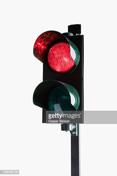 A stoplight with the red light illuminated