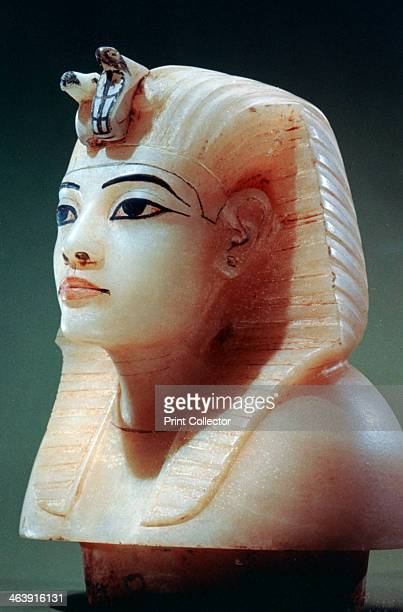 Stopper from one of the canopic urns from the tomb of Tutankhamun 18th Dynasty The head of the king is wearing the nemes royal headdress The urn...