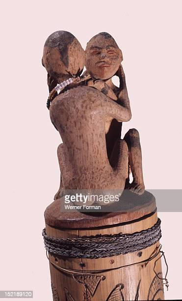 A stopper in the form of a homosexual couple on a bamboo container Indonesia Dayak 19th 20th c Kalimantan Borneo