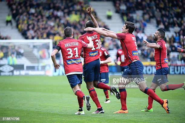 Stoppila Sunzu of Lille celebrates his goal with his team mates during the French League 1 match between Fc Nantes and Lille OSC at Stade de la...