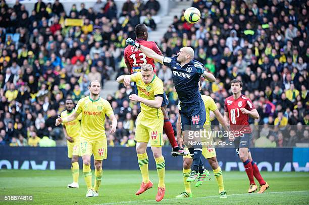 Stoppila Sunzu of Lille scores a goal against Kolbeinn Sigthorsson and Remy Riou of Nantes during the French League 1 match between Fc Nantes and...