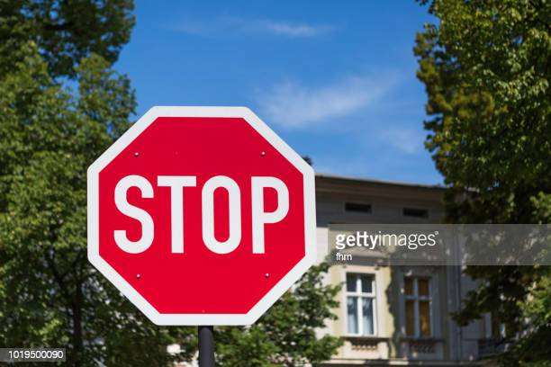 stop-sign with facade in the background - stop sign stock pictures, royalty-free photos & images