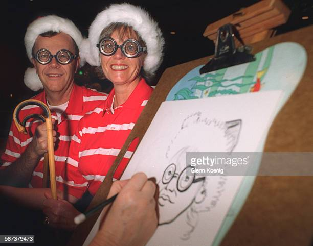 LSStop/Waldo1026GK–left to rightTerry Hartshorn and Sharon Hartshorn with their WhereÕs Waldo costumes as Sharon has her caricature done During the...