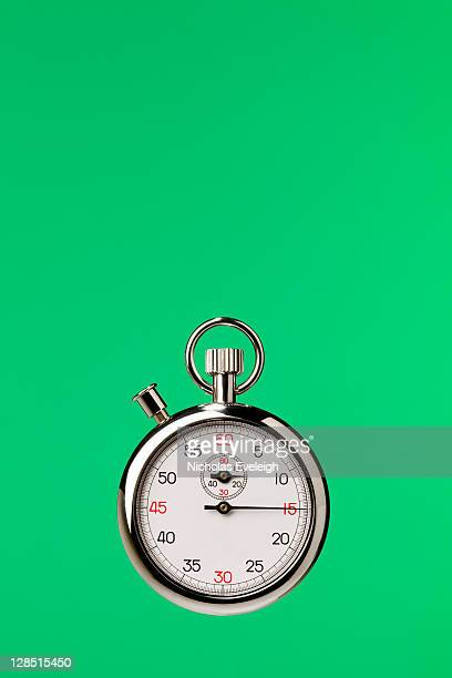 Stopwatch against green background
