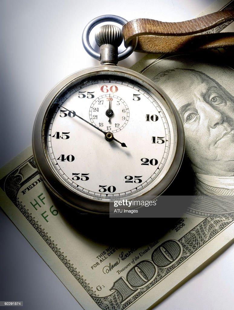 stopwatch hundred dollar bill : Stock Photo