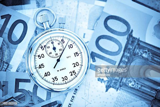 stopwatch on euro banknotes medium