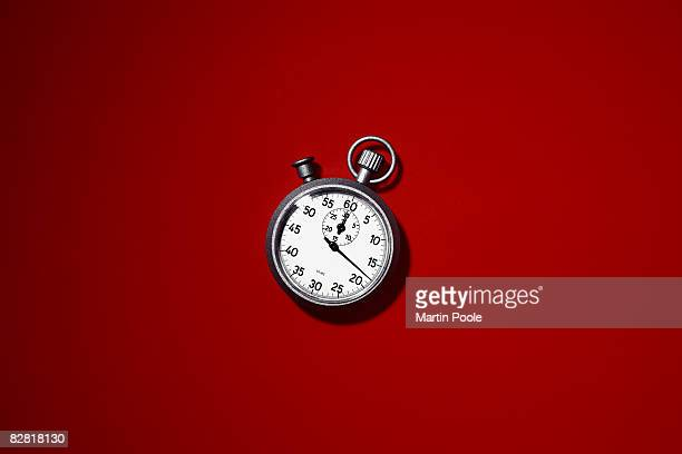stopwatch on red background