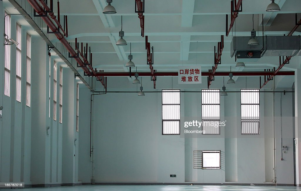 A storage area stands empty in a logistics center at China (Shanghai) Pilot Free Trade Zone's Pudong free trade zone in Shanghai, China, on Thursday, Oct. 24, 2013. The area is a testing ground for free-market policies that Premier Li Keqiang has signaled he may later implement more broadly in the world's second-largest economy. Photographer: Tomohiro Ohsumi/Bloomberg via Getty Images