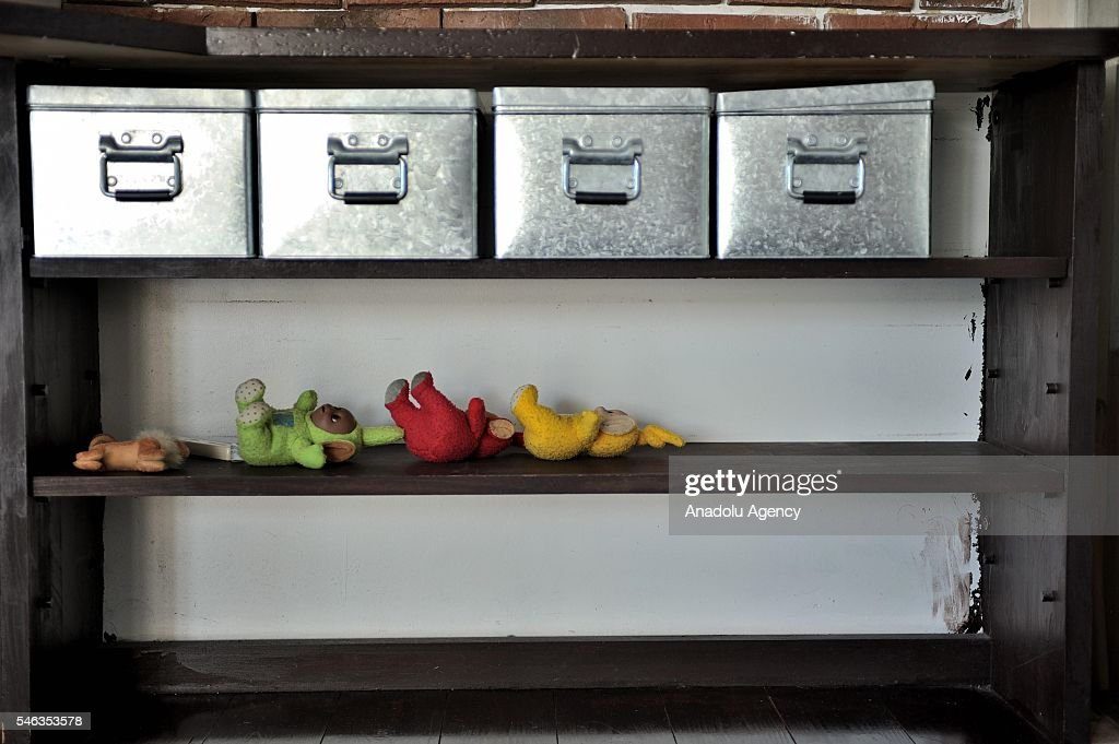 Storage boxes and toys are seen on a shelf at the apartment of Minimalist Naoki Numahata in Tokyo, Japan, on July 02, 2016. Naoki Numahata, 41, a freelance writer who lives with his wife and their daughter, decided to live less cluttered with useless personal and domestic possessions during a travel and after meeting a family who live quite simply in Croatia. This philosophy 'Minimalism' has become famous in recent years in Japan especially between young people who want nothing to do with acquiring material possessions, but would rather spend their money, time, and effort on things that they truly enjoy. Minimalism is a different style that uses pared-down design elements. Minimalism in the arts began in postWorld War II Western art, most strongly with American visual arts in the 1960s and early 1970s.