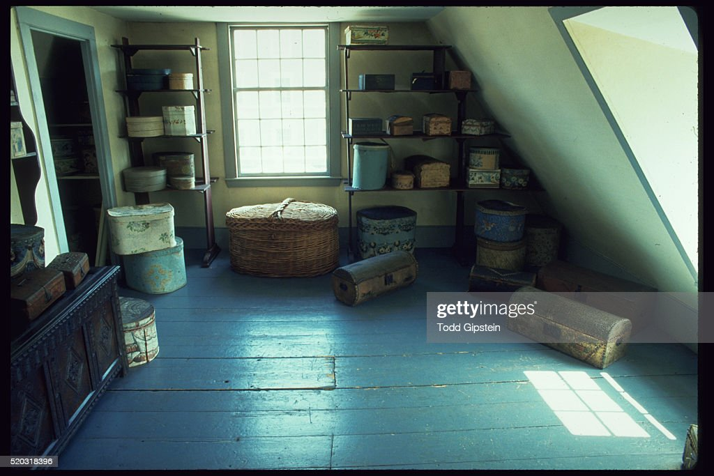 Storage Containers In Attic Of Historic House
