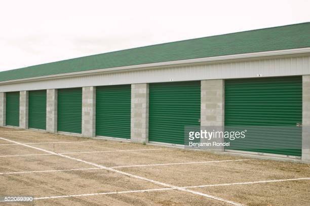storage facility with green doors - self storage stock pictures, royalty-free photos & images