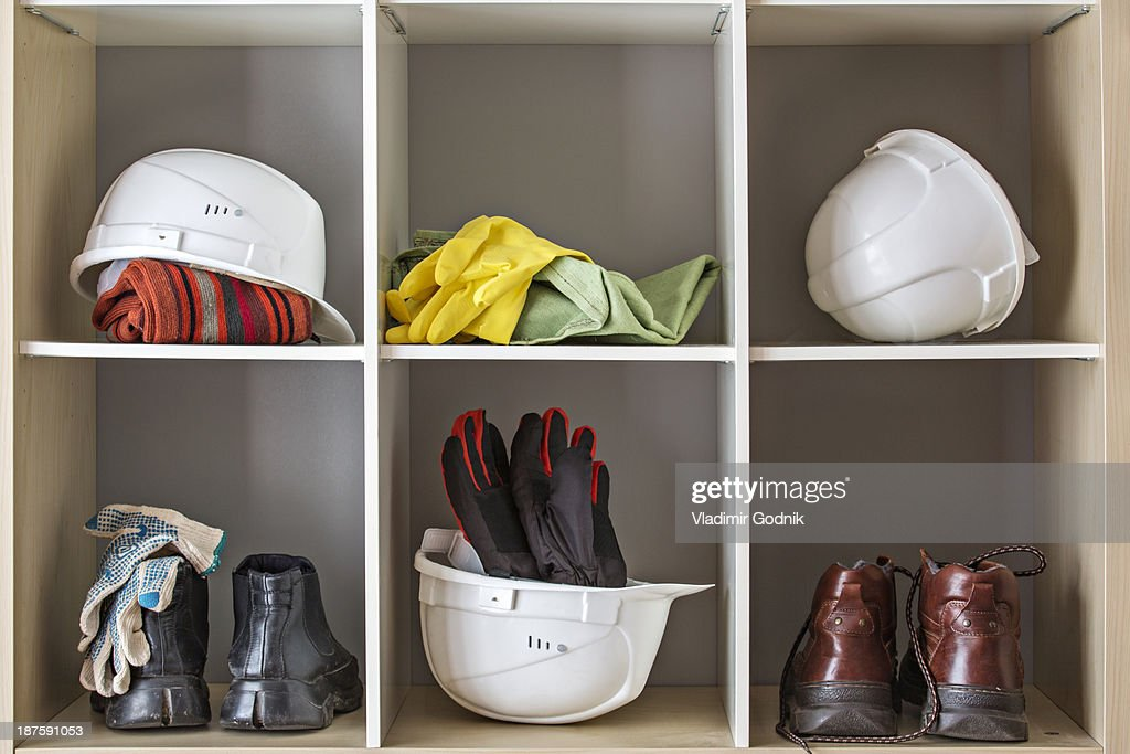 Storage of protective headwear, footwear and gloves : Stock Photo