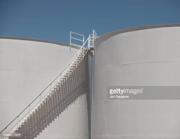 storage silo stairs and shadow study - vorratstank stock-fotos und bilder