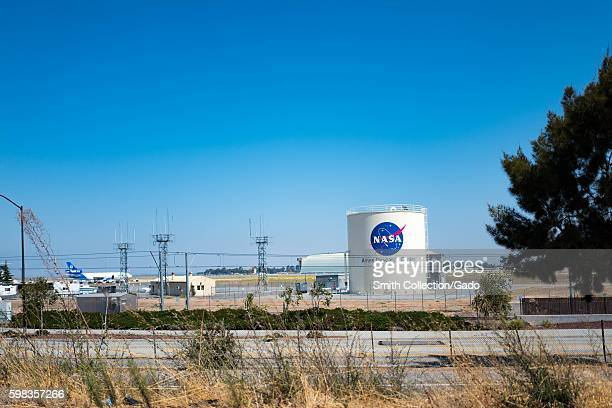 Storage tank with logo for NASA Ames Research Center with Moffett Field visible in the background in the Silicon Valley town of Mountain View...