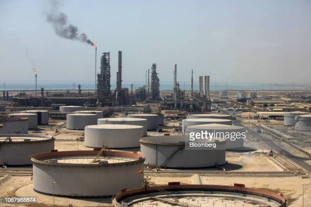 Storage tanks and oil processing facilities operate at Saudi Aramco's Ras Tanura oil refinery and terminal in Ras Tanura Saudi Arabia on Monday Oct 1...