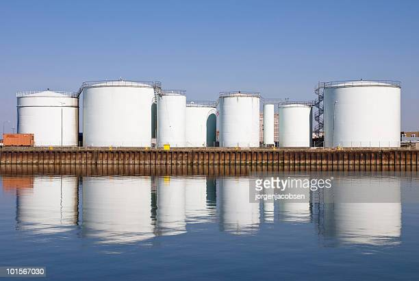 storage tanks at harbor - storage tank stock photos and pictures