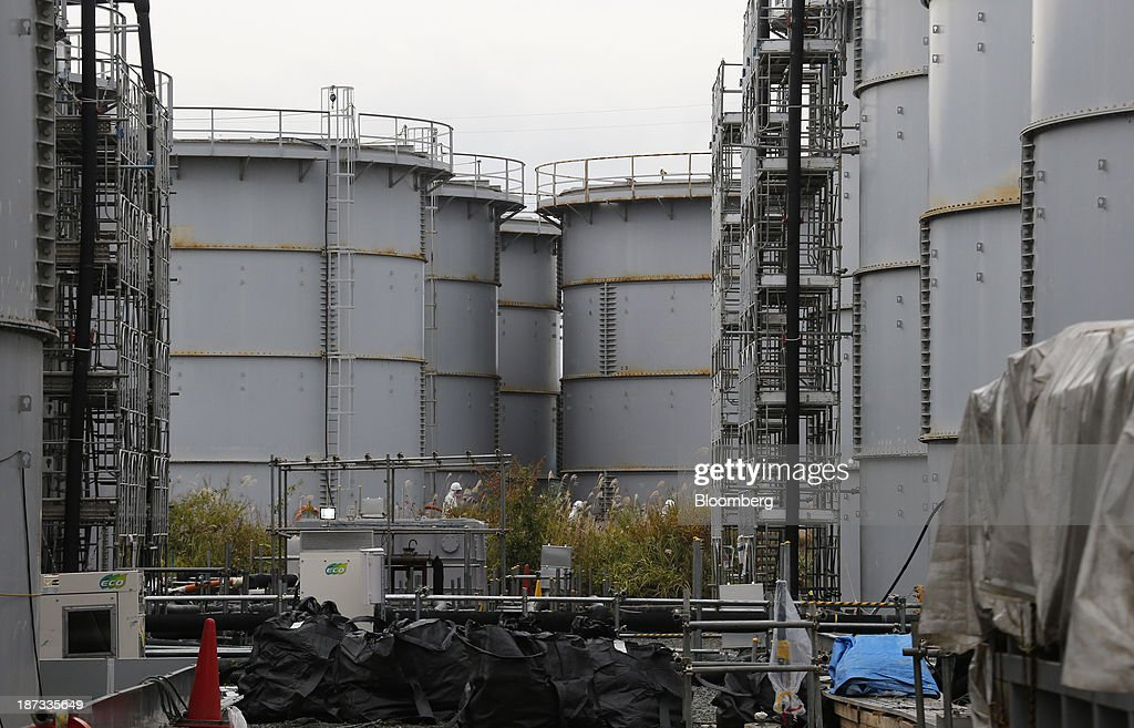 Storage tanks for radioactive water stand at Tokyo Electric Power Co.'s (Tepco) Fukushima Dai-ichi nuclear power plant in Okuma, Fukushima Prefecture, Japan, on Thursday, Nov. 7, 2013. Tepco, which returned to profitability in its first-half earnings report on Oct. 31, is handling an estimated 11 trillion yen ($112 billion) cleanup of the nuclear plant wrecked by an earthquake and tsunami in 2011. Photographer: Kimimasa Mayama/Pool via Bloomberg