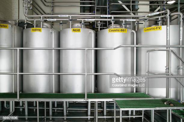 storage tanks in warehouse - acid stock photos and pictures