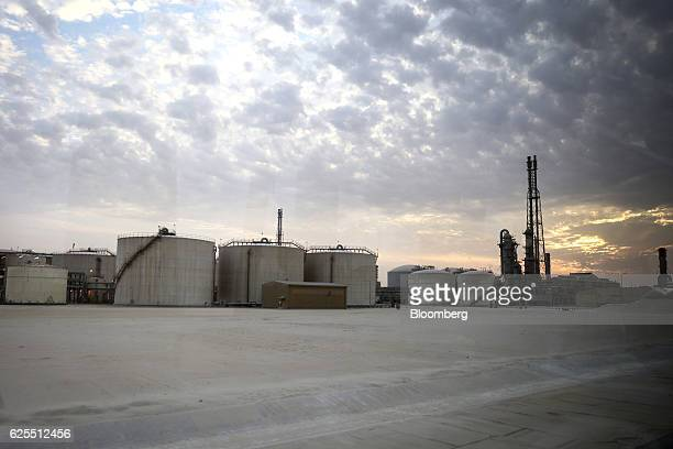 Storage tanks sit at the phosphate processing plant at the Ras Al Khair Industrial City operated by the Saudi Arabian Mining Co in Ras Al Khair Saudi...