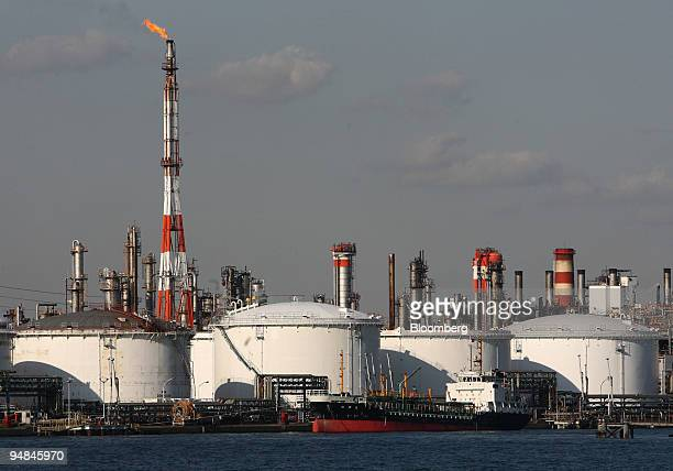 Storage tanks stand at a TonenGeneral Sekiyu KK oil refinery in Kawasaki City Kanagawa Prefecture Japan on Wednesday Nov 26 2008 Japan's crude oil...