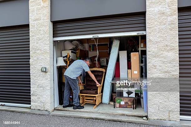 storage warehouse holding the contents of a house - self storage stock pictures, royalty-free photos & images