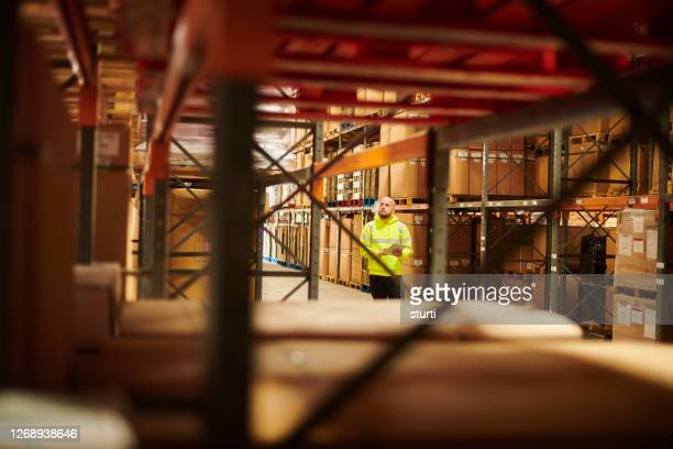 storage warehouse stockcheck - built structure stock pictures, royalty-free photos & images