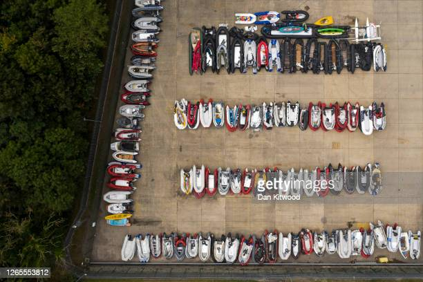 Storage yard for the dinghies, ribs and rowing boats previously used by migrants to cross the English Channel from France is seen on August 12, 2020...