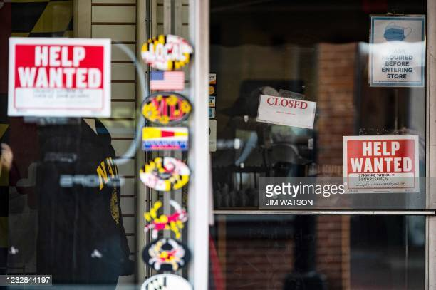 Store advertises a Help Wanted sign in Annapolis, Maryland, on May 12, 2021. - US consumer inflation surged 4.2 percent last month compared to April...