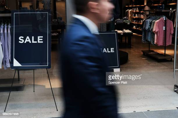 A store advertises a sale in a window of a Manhattan shopping mall on June 28 2018 in New York City The American economy showed the weakest...