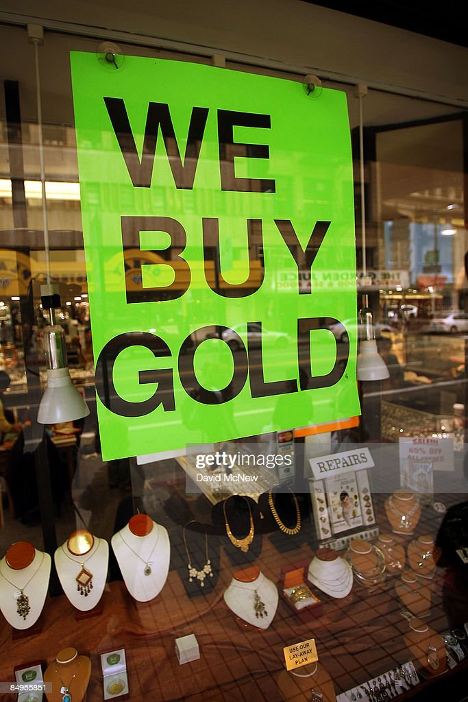 A store advertises to buy gold in its sidewalk window display on February 20, 2009 in Los Angeles, California. Gold futures finished the day above $1,000 an ounce for the first time in nearly a year, with investors eyeing the precious metal as a safe haven from declining stock markets and plummeting real estate values. April delivery of gold finished the day at $1,002.20, up $25.70, or 2.6 percent.