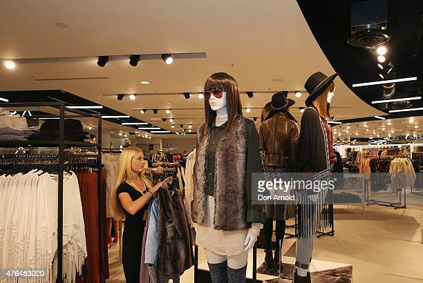 Store assistant attends to a mannequin at the opening of the 'FOREVER 21' flagship store on Pitt Street on June 10, 2015 in Sydney, Australia.