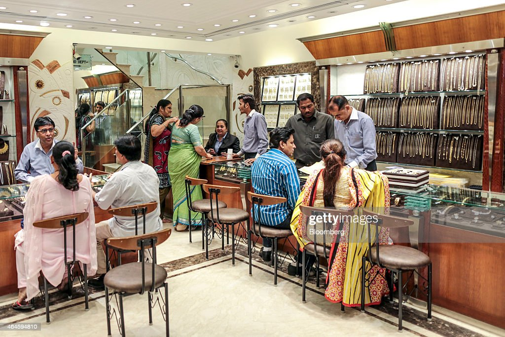 Store assistants serve customers browsing gold in the Dwarkadas Chandumal Jewelers store in the Zaveri Bazaar area of Mumbai, India, on Thursday, Feb. 26, 2015. India's Finance Minister Arun Jaitley will present this year's budget on February 28. Speculation that Prime Minister Narendra Modi's policies will boost economic growth has propelled India's Sensex to the world's third-biggest gain among major markets during the past 12 months. Photographer: Dhiraj Singh/Bloomberg via Getty Images