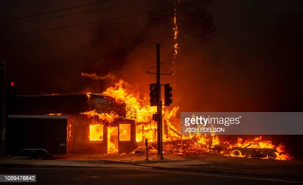 TOPSHOT A store burns as the Camp fire tears through Paradise California on November 8 2018 A rapidly spreading lateseason wildfire in northern...