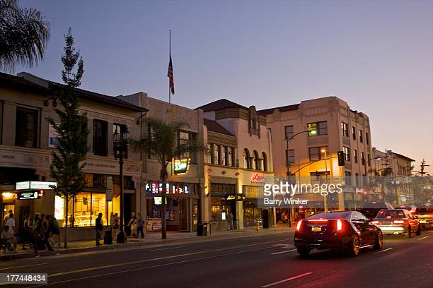Store, car and streetlights at dusk