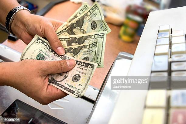 Store cashier counting the cash