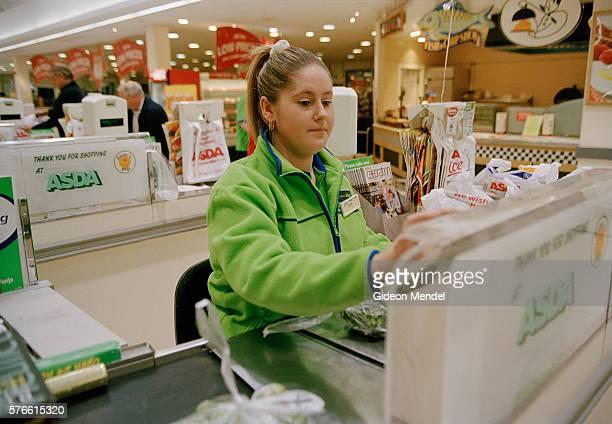 ASDA Store Clerk at Cash Register